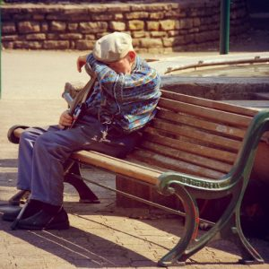 Old man sitting on park bench Le Banc Ideal