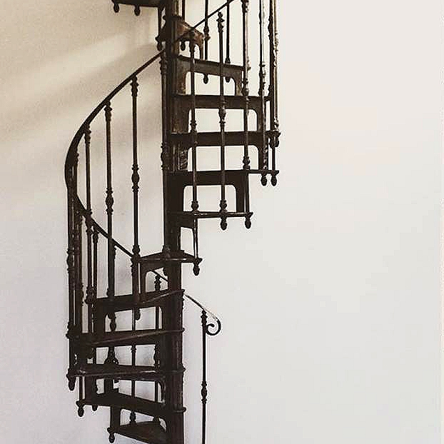 Spiral staircase home interior design french cast iron for Interior spiral staircase designs